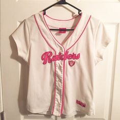 Pink/white Raiders Jersey Pink/white Raiders jersey for her. In great condition except for a tiny stain. NFL Tops