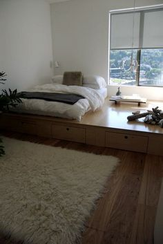 I LOVE how this is not really a bedframe, it becomes a whole new level in the room.