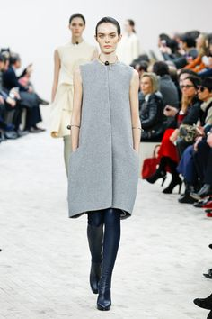 LoVe The Oversized Vest/Coat Look Paired With Snug Leather Knee Boots