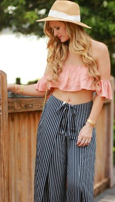 Florida fashion blogger styles ruffle crop top with stripe wide leg pants and straw hat for a casual summer vacation outfit