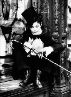 femmedandy        I have such deep, deep love for this aesthetic, and all it is referencing.   It reminds me of my tremulous desire to be a dapper Robert Smith.  And dear god something in me just loves the pairing of asskicking boots with an otherwise perfectly appointed outfit.