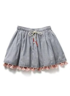 100% Cotton skirt trimmed with pink tassels. Elasticated waistband with button trimmed ties.