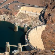 Looking for an exciting way to see the Grand Canyon and Hoover Dam? See pics and details of our experience on a Grand Canyon helicopter tour from Las Vegas. Grand Canyon Helicopter Tour, Las Vegas With Kids, Hoover Dam, Las Vegas Strip, Aerial View, Bridges, Buildings, Tours, Places