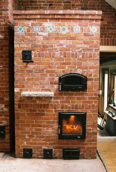 Russian fireplace with pizza oven the russian fireplace for Brick jet stove