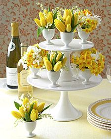 Easter centerpiece with egg cups for vases, Pottery Barn has cute egg cups.
