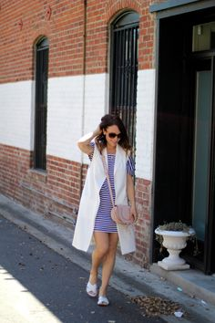 White longline vest, stripe dress