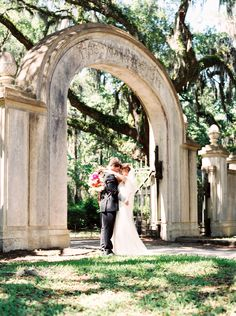 Bride and groom at Wormsloe Historic Site in Savannah, GA. Image by Simply Sarah Photography.
