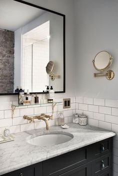Simple beautiful Brooklyn bathroom inspiration with subway tile and gold hardware accents