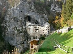 Predjama Castle, Slovenia. Dates from the 13th century and built from the natural limestone of the mountain and originates within the mouth of a cave.