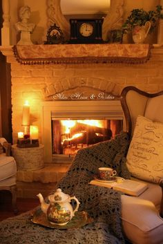 I like how the fireplace looks like its in a picture frame. Have fireplace flush and higher up so you can add pictures around the fire. Make the fireplace look like its a moving picture. Style Cottage, Cozy Cottage, Cozy House, Cozy Cabin, Irish Cottage Decor, Style Anglais, Cozy Fireplace, Cottage Fireplace, Fireplace Modern