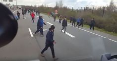 """DASHCAM VIDEO SHOWS HUNDREDS OF """"REFUGEES"""" ON EUROPEAN HIGHWAY Video was posted on November 26, 2015."""