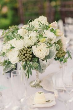 #centerpiece  Photography: Carlie Statsky Photography - carliestatsky.com  Read More: http://www.stylemepretty.com/2014/06/10/outdoor-elegance-at-the-kohl-mansion/