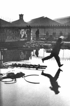 Henri Cartier-Bresson (1908-2004)  Detrás de la Gare Saint-Lazare, 1932  one the best photo of Bresson! the sublime position of the man! he does not touch the water! suberb!