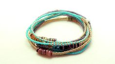Beaded with high quality Czech seed beads and features rainbow hammershell beads. You can coordinate this necklace with any outfit from business casual to everyday wear. This charming beaded piece is intended as a necklace, but is so versatile and easy to wear, you can wear it as a multi wrap bracelet or anklet too! Beaded on strong elastic cord it measures 54 inches. If you need the length adjusted I will be happy to make it specific for you.