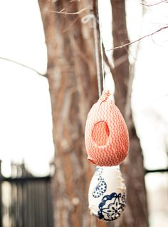 Modge podge plastic eggs to transform into bird feeders (or rustic Christmas tree ornaments!) by A Subtle Revelry