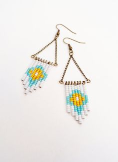 White, blue, and yellow beaded earrings