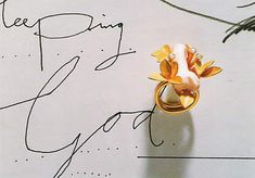 """""""Sleeping God (ring)""""by Manfred Bischoff, 1998. Fine gold, coral, diamonds."""