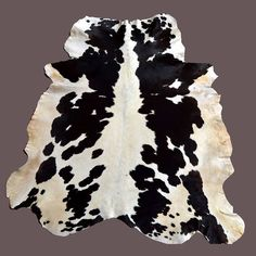 **THE ITEM SHOWN IS THE ACTUAL ITEM YOU WILL GET** This is a natural cowhide rug. Every cowhides rug we carry is of the highest quality! Cowhide rugs are stylish and durable, making them an ideal choice for homes with children or pets. Cowhide rugs are easy to clean, and look beautiful on both wooden and stone flooring.  Cowhides look fantastic used as rugs on wooden and stone flooring, but also make unique wall hangings or draped over a sofa or a chair. Use them as a rug, a wall hanging…