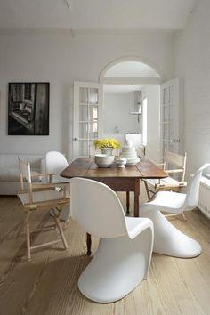 White walls, pine floors and Panton chairs