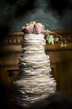 3 tier wedding cake with ruffles edged in edible gold leaf