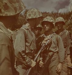 United States Marines with rifles and fixed bayonets prepare for bayonet training on Guam, August 1945. These troops are armed with the M1 rifle,the basic service rifle of the United States Marine in World War II.