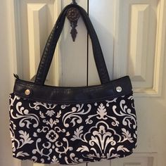 Skirt purse with classic black/white pattern skirt NWOT. Thirty one skirt purse (this one zips!). Comes with black Parisian pop detachable skirt.  Interior has one  zip pocket and one open pocket. 14 x 9 with 9 inch handle drop. Thirty one Bags Satchels