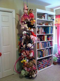 Revelations of a Reluctant Stay-at-Home Mom: Stuffed Animal Zoo Tower from a sho. Revelations of a Reluctant Stay-at-Home Mom: Stuffed Animal Zoo Tower from a shoe tree Stuffed Animal Displays, Stuffed Animal Holder, Organizing Stuffed Animals, Storing Stuffed Animals, Stuffed Animal Storage, Diy Stuffed Animals, Stuffed Animal Zoo, Stuffed Toys, Kids Storage
