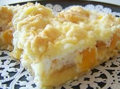 """Peachy Keen Barsfor 12//1 pkg cake mix-wh, yel, fr van.1/3 c butter soft. 2 lg   egg, divide.29 oz can peach sl drain.  8 oz cr cheese soft.-1/3 c sgr-1 t vani-   Mix cake mix, but, 1 egg; fork crumb.  Save 1 ½ c. crumbs for top. Press  remain crumbs bottom of 9x13 spray pan; Bake 350-10 min. Cut fruit to 1"""" ; Spoon to crust. Beat cr chse, sgr, 1 egg,van; beat creamy. Top peaches.   Sprkl w/crumbs; Bake 30 minutes.    Chill 30 minutes before serving; Serves 12.Store leftovers in refrigerator."""
