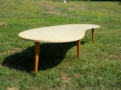 This Oval Drum End Table Is A Fun Piece That Tapers From Its Top To - Mid century modern boomerang coffee table