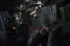 Giulio Piscitelli x Contrasto — March 20th, Pisky (Ukraine) — Ukrainian soldiers from Dnipro volunteer battalion firing a machingun from a trench.