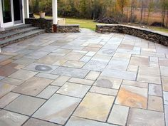 Patio of stone, but with spaces between the stones for ground cover plants like thyme.