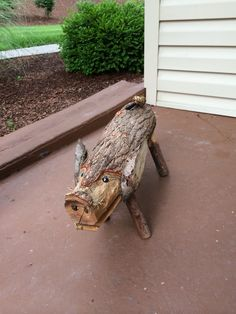 Cute pig made out of a log.