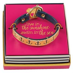 3 styles: navy anchor, pink seahorse and white whale. Saffiano vegan leather bracelet has shiny gold metal bar that features sealife icon cut-outs. Gold toggle closure. Arrives in gold foil gift box that reads, 'live in the sunshine swim in the sea.'
