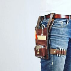Close up of the custom tool belt that made for me! Traditional tool belts are too bulky and the leg strap makes sure this one moves with me and doesn't flap. Leather Tool Belt, Leather Apron, Leather Pouch, Leather Tooling, Crea Cuir, Tool Pouch, Homemade Tools, Hip Bag, Leather Projects