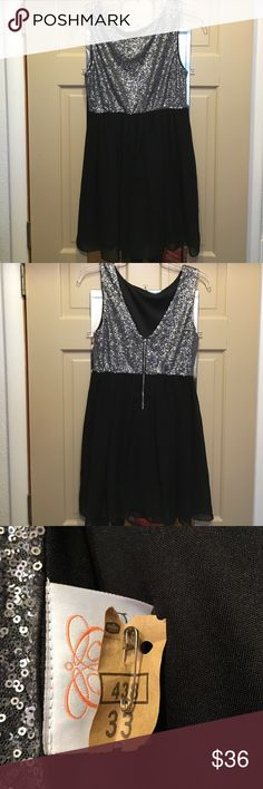 New Years Eve Dress Great silver sequined and black dress. Low back. Size M great for size 6 or 8 Dresses Mini