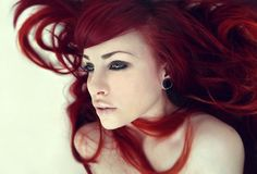 Long bright red hair.