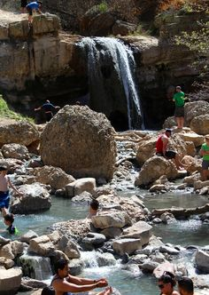 Hike to a natural hot spring with a gushing waterfall! This Utah trail should be on every Utah family's bucket list!