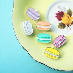 We are thrilled to stock these beautiful French Macaron Pins from Paper Flour InkThere are six to choose from, in the prettiest pastel colours! Or get the full set for a special price!They come beautifully presented on a laser cut backing card.20mm, rubber back