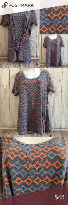 Stretchy Perfect Tee by LuLaRoe Really comfy and stretch Perfect tee. It has a factor wash fade look with orange and light blue pattern. Size small. Side slits on bottom sides. Sorry no offers please. LuLaRoe Tops Tees - Short Sleeve