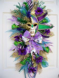 Mardi Gras wreath for Fat Tuesday. Purple, green and gold silk flowers.
