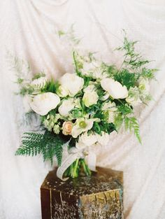 Winter whites and fern bouquet by Sarah Winward.  Photo by Leo Patrone.