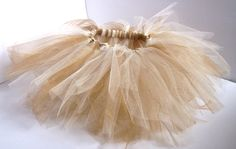 Ivory and Gold Shimmery Tulle Tutu for baby/infant/child/toddler. $25.00, via Etsy.