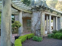 Stone wall surrounding the Italian Gardens at hatley Park. Our idea of color/stone and wood combination.