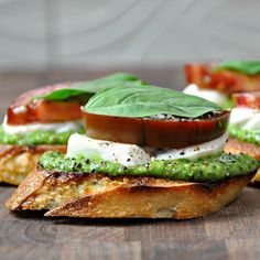 Caprese Crostini with Pesto -- I'm normally no fan of walnuts in my pesto but friends argue it gives the bread a robust density otherwise unavailable.