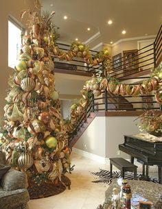 Christmas tree and stairway in gold scheme. Gorgeous!