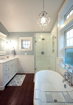 Traditional Master Bathroom - Come find more on Zillow Digs! Dark wood tile for floors. Sky blue and white walls