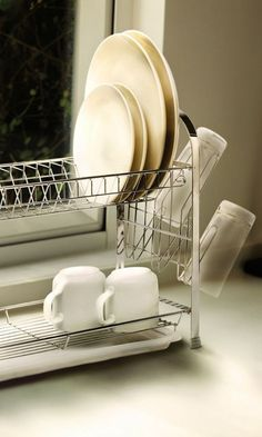 This two-tier dish rack is an absolute necessity for small kitchens.   33 Ingeniously Designed Products You Need In Your Life