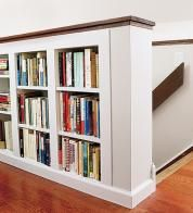 Look for ways to work storage into the room's interior. Here, a half-wall along a staircase doubles as a bookshelf next to a home office.