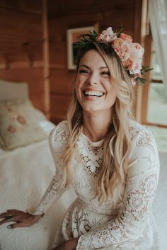 """I kept my hair loose and wavy with some braids worked in to hold a crown of fresh flowers. The makeup look was natural and dewy with a flush of peach to match the flowers""- the bride 