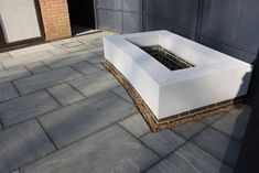 A bespoke brick built rendered curved planter  set into a newly laid patio. Waiting for spring planting and all will be transformed.